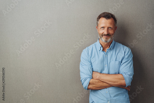 Fototapeta Bearded middle-aged man with a friendly smile obraz
