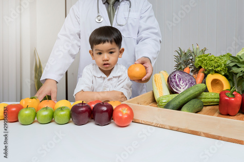 A boy and doctor happy to have healthy food Wallpaper Mural
