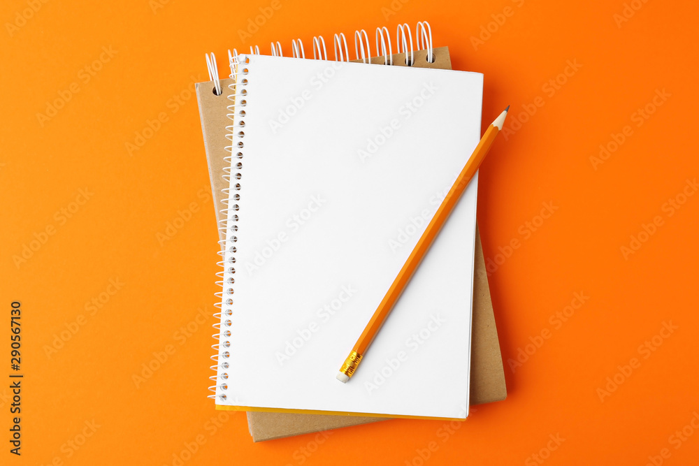 Fototapety, obrazy: Notebooks with pencil on orange background, top view