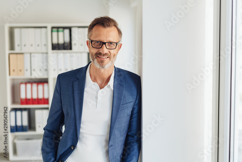 Vászonkép  Smart bearded businessman wearing glasses