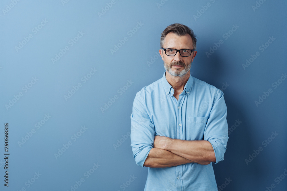 Fototapeta Serious authoritative man with folded arms