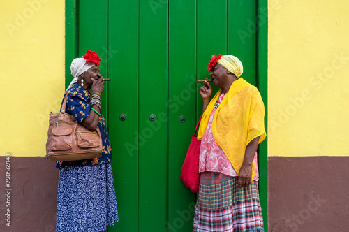 Two Old Cuban ladies smoking a large cigar in La Havana, Cuba Wallpaper Mural