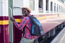 Male Tourist Boarding Train