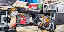 E-waste Heap From Used Computer Parts. Refuse Separation And Recycling. Obsolete Or Discarded PC Hardware Components Such As Printers, Chassis, Keyboards And Mice. Environmental Contamination Problem.