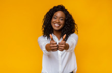 Happy Young Black Woman Showing Thumbs Up