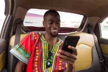 Man Checking Phone In A Taxi