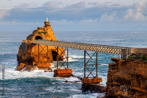 The Rock of the Virgin Mary, an iconic landmark of Biarritz, France. A metal bridge which leads to it is designed by Eiffel.