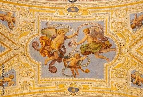 OSSUCCIO, ITALY - MAY 8, 2015: The baroque fresco of angels with the mariological inscriptions in church Sacro Monte della Beata Vergine del Soccorso by Salvatore Pozzi di Puria (1595 – 1681).