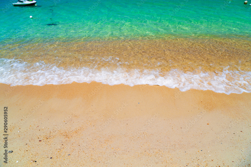 Fototapeta Ocean turquoise, yellow sand, waves, sunlight.