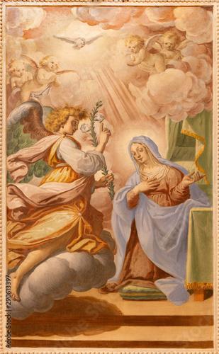 OSSUCCIO, ITALY - MAY 8, 2015: The baroque fresco of Annunciation in church Sacro Monte della Beata Vergine del Soccorsoby Salvatore Pozzi di Puria (1595 – 1681).