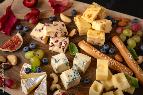 Door stickers Buffet, Bar Wooden board with different types of cheese, nuts, berries and fruits.