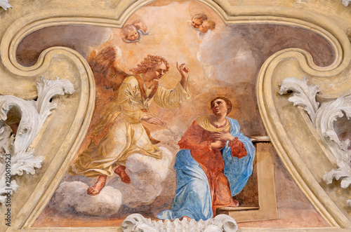 RIVA DEL GARDA, ITALY - JUNE 13, 2019: The ceiling fresco of Annunciation in Chiesa di Santa Maria Assunta (Cappella del Suffragio) by Giuseppe Craffonara (19 cent.).