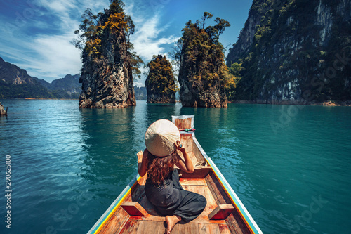 Fotografie, Obraz  young woman tourist in asian hat on the boat at lake