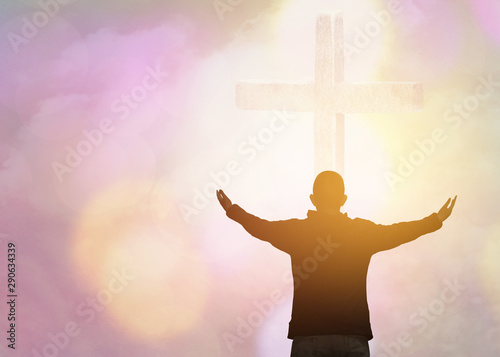 Fotografie, Obraz soft focus and Silhouettes of man raise hand up worship God over the cross in cloudy sky