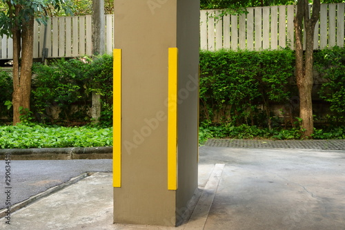 Closeup corner guard or column protector made from stainless steels attached to concrete column in parking lot Wallpaper Mural