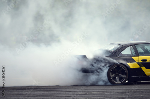 Cuadros en Lienzo Motion blur close up drift car with  smoke from burning tires