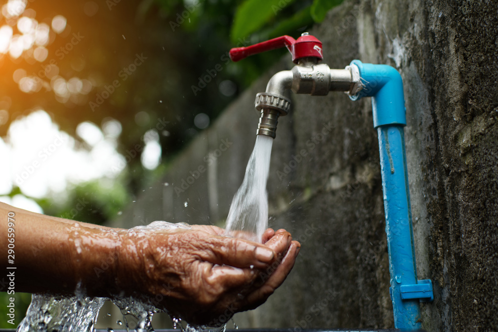 Fototapety, obrazy: Old hand and faucet ,Water shortage and drought concept.