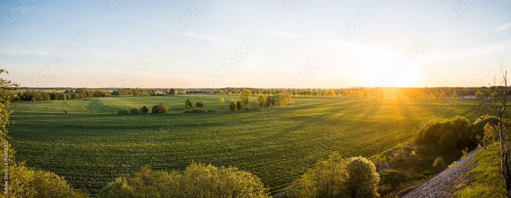 Fototapety, obrazy: Beautiful sunset at summer day. Amazing nature landscape. View from the top of the hill. Green fields and trees.