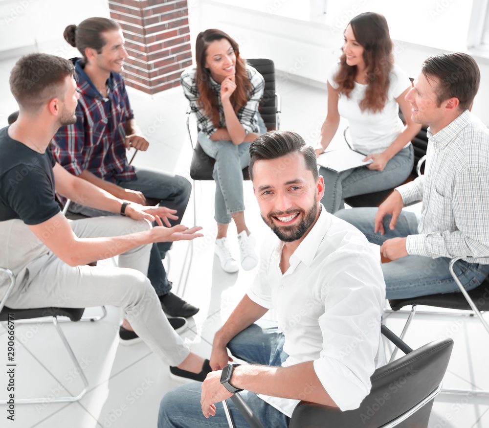 Fototapety, obrazy: Manager and his team sitting in the office