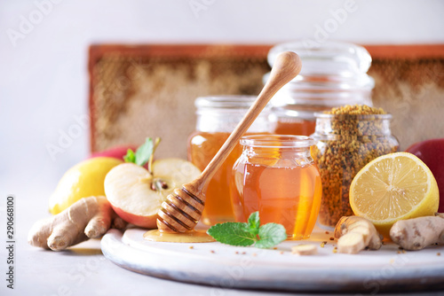Ingredients for healthy hot drink. Lemon, ginger, mint, honey, apple and spices on grey background. Copy space. Alternative medicine concept. Clean eating, detox