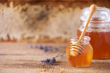 Herbal Honey With Lavender Flowers, Bee Pollen Granules, Honey Conb On Grey Background. Autumn Harvest Concept