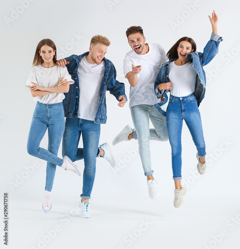 Printed kitchen splashbacks Artist KB Group of jumping young people in stylish casual clothes on white background
