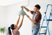 Happy Couple Doing Repair In Their New House
