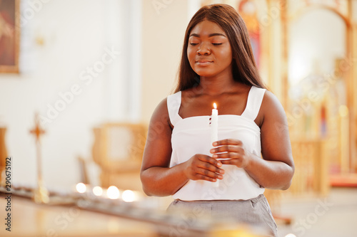 African american woman praying in the church Canvas Print