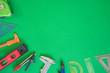 Leinwanddruck Bild - Concept architects, equipment architects On green paper background