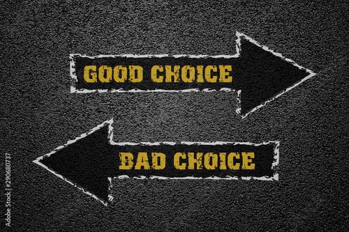 Photo  Good and bad choice concept on asphalt ground