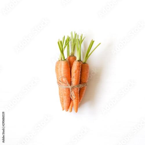Bunch of fresh carrots on white wooden background Wallpaper Mural