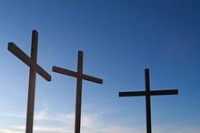 Three Crosses Against Blue Sky