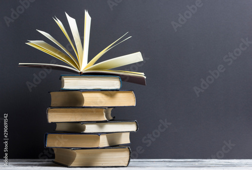 Fotografering  Open book, hardback books on wooden table