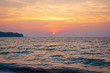 sunset on the sea. sandy beach, clear water, waves. surf line in the warm colors of the setting sun.