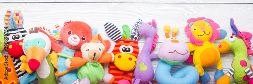 Colorful kids toys frame on wooden background Fototapet