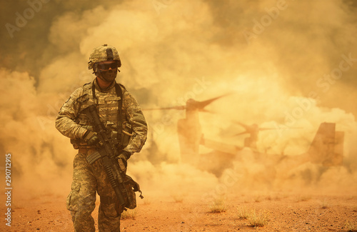 Military helicopters and forces between storm & dust in battlefield