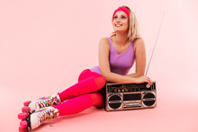 Image Of Smiling Pretty Woman Using Tape-player While Sitting On Floor