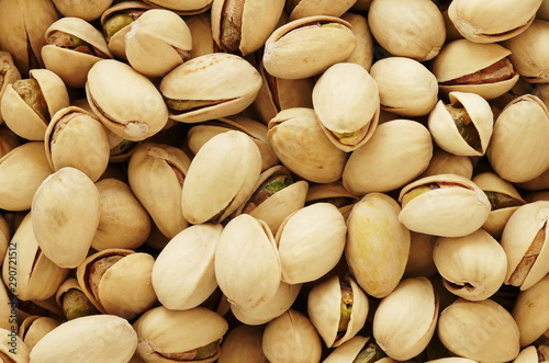 Valokuvatapetti pistachios nuts close up full frame texture background.