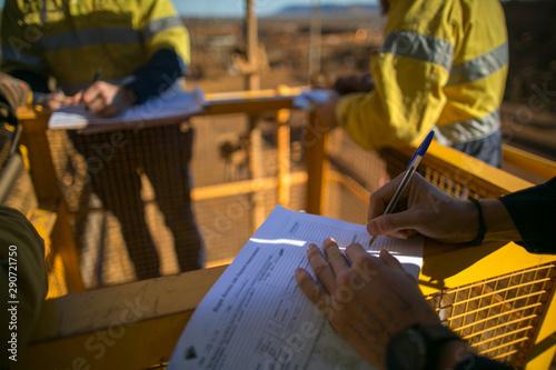 Fotografie, Obraz  Rope access miner supervisor sigh of JSA risk assessment permit to work on site