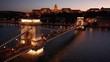 night flying left over Szechenyi Chain Bridge in Budapest