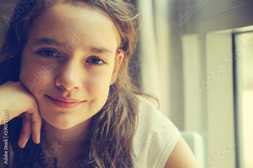 Fotografiet  Teenage girl is sitting indoor in urban cafe