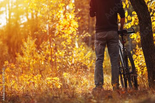 Cuadros en Lienzo  Man cyclist in the autumn forest. lifestyle autumn nature trip