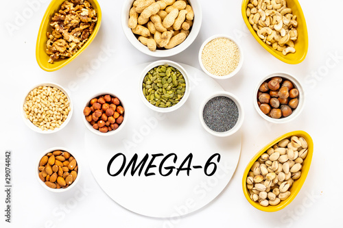 Fotografia  Top View of Variety of Nuts and Seeds on the White Background with Omega-6 Text