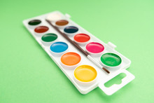 Watercolor Paints In Box On Green Background