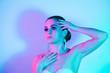 canvas print picture Studio portrait of fashion model in neon lights