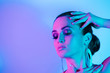 canvas print picture High Fashion model in metallic blue and pink lights