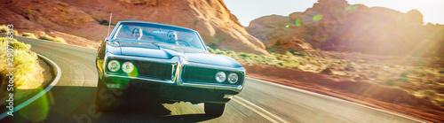 Cuadros en Lienzo driving fast through desert in vintage hot rod car