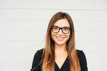 Close Up Portrait Of Beautiful Young Businesswoman Wearing Eyeglasses