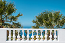 Terrace Balluster With Ocean View, Blue Sky And Palm Tree Background