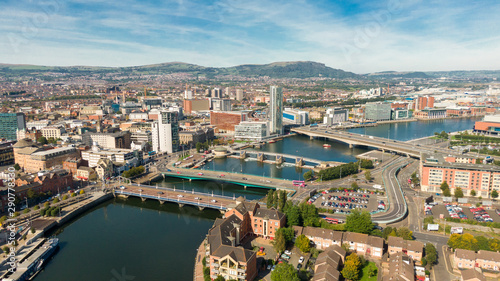 Fotografie, Obraz Aerial view on river and buildings in City center of Belfast Northern Ireland